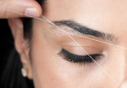 выщипывать брови ниткой